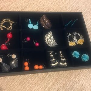 12 pair of earrings for pierced ears.